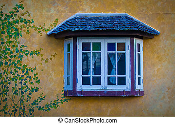 Vintage window - Vintage style window on yellow wall with...