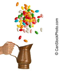 Hand with tin jug catching jelly beans - Hand holding tin...