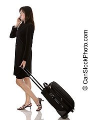 traveller - older business woman with luggage on white...