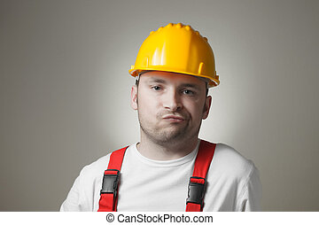 Disappointed young worker - Unhappy young handyman with...