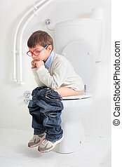 baby on toilet - little child on the toilet thinking