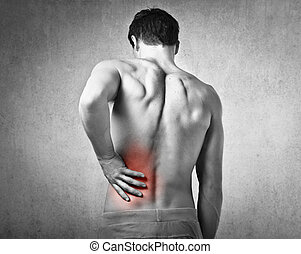 Man with backpain - Shirtless man holding his back in pain