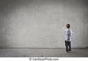 child turned back - baby turned back on gray background