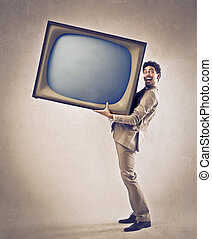 Man with TV - Man holding huge TV