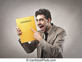 employment contract - happy businessman holding contract of...