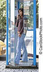 Phone cabin - Woman calling in a phone cabin.