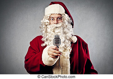 Santa Claus interview - santa claus with a microphone on...