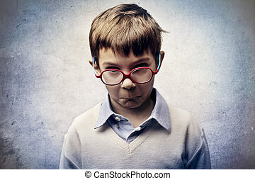 sad child - portrait of sad little boy with glasses on gray...
