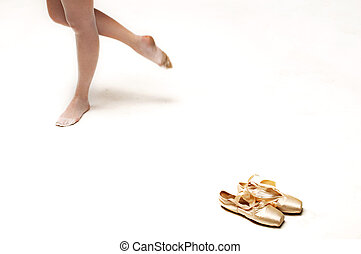dancer with her ballet shoes