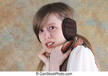 Girl with earmuffs - Blonde girl at cold with knitted brown...