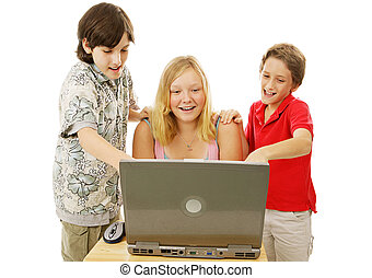 Kids Having Fun Online - A group of kids having fun using a...