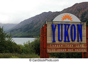 welcome to yukon sign - yukon sign against mountain backdrop
