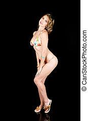 Young Girl in a Bikini - Young girl posing in a bikini after...
