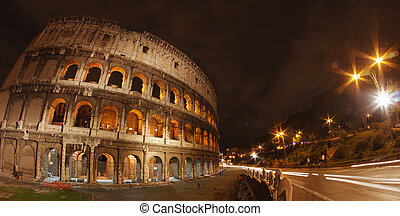 Colosseum at Night, Rome - Wide Angle view with car light trails