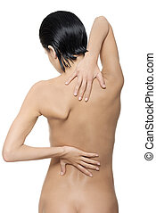 Young woman with pain in her back Isolated on white
