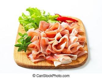 Prosciutto di Parma - Thin slices of Prosciutto di Parma on...