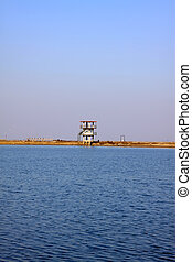 watchtower under the blue sky, in the blue sea, north china