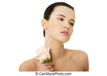 Young woman with health skin and with flower