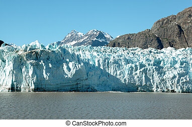 alaskian glacier - glacier bay, alaska, with snow-capped...