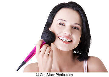 Attractive woman doing make-up on face. Isolated
