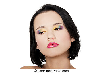Beautiful woman with rainbow eye make up