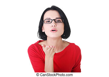Young woman blowing a kiss on white background