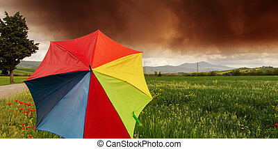 Tuscany Countryside with Storm and colorful Umbrella, Italy