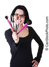 Make-up artist holding brushes - Young make-up artist woman...