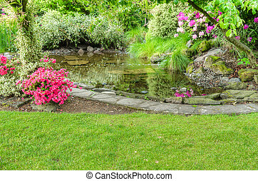 Landscaped garden scene with fish pond - A garden scene with...