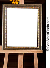 old picture frame with white cut out canvas on easel -...