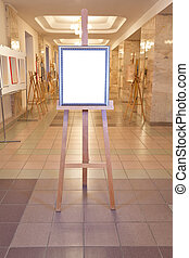 picture frame on easel in art gallery hall