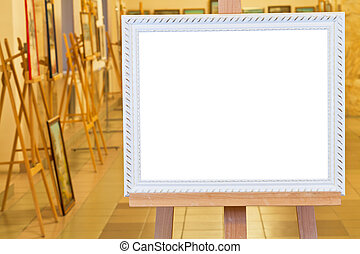 white picture frame on easel in gallery hall