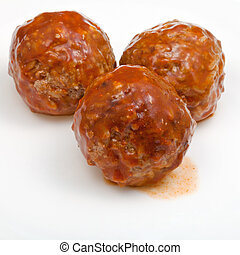 three meatballs under meat sauce - three roasted meatballs...
