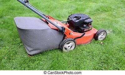 worker push grass mower
