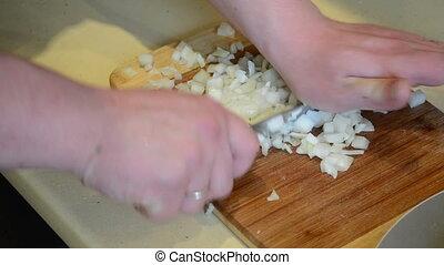 cut onion knife on board