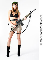sexy woman with weapon - Beautiful sexy blond woman isolated...