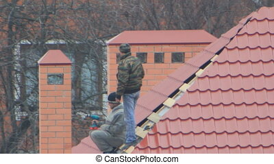 Two man on the roof - Two man on the red tile roof