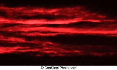 Red clouds on the dark sky