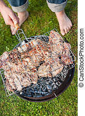 Grilled meat on a charcoal grill