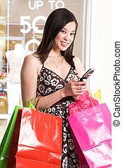 Shopping woman - A shot of a beautiful asian woman carrying...
