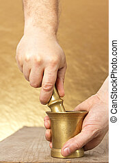 Close up of man hands with mortar and pestle