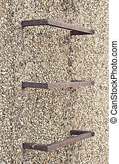 Steel ladder. - Steel ladder in gravel wall.