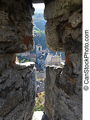 View to Bellinzona town through the ancient arrow-loop