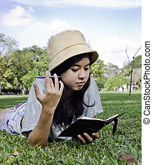 Young beautiful asian woman with book