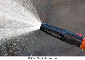 Water from a garden hose - Water spraying from a garden hose...