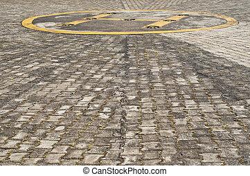 Helipad. - Helipad on concrete block floor.