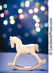 Rocking horse - Wooden rocking horse over christmas lights...