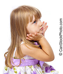 Little beautiful girl holding her head