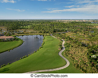 Florida Golf Course Flyover Aerial - Aerial photograph taken...