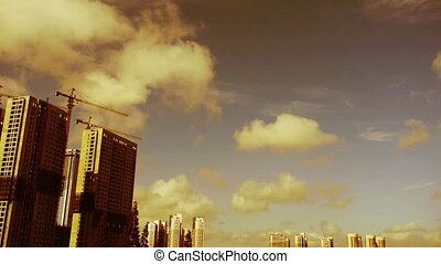 Movement of altocumulus clouds in sky,building high-rise &...